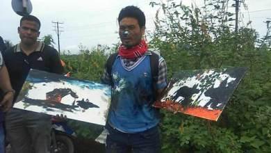 Photo of Sirumoni Doley of Jorabat doing painting using his nose for World Record