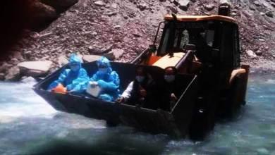 Ladakh: Covdi-19 Warriors Crossing a river in JCB Machine