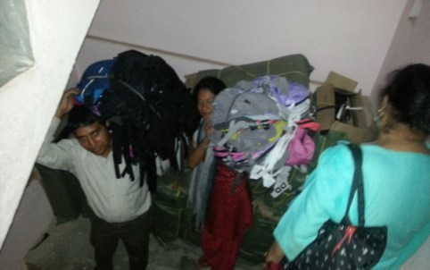 loading 600 backpacks into the big bus ArunasNepalRelief, Inc. has rented with relief funds