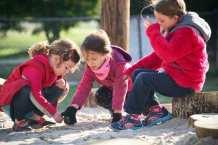 Potomac Crescent Waldorf School Mixed-Age Kindergarten girls creative problem solving in sandbox