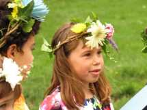 Waldorf Early Childhood student wearing a may day crown