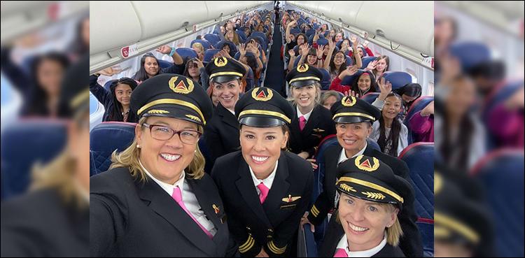 Photo of all-women flight crew takes 120 ladies to NASA headquarters