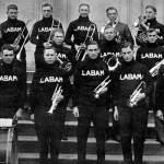 The 15 members of the UA band pose with director Dr. Gustav Wittig in 1915.