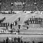 """The Million Dollar Band on the football field, forming the letters """"U"""" and """"A."""""""
