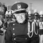 Colonel Butler in foreground, band members behind him.