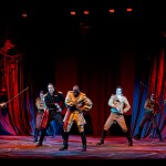 Fighting onstage, a group of actors depicts the conflict in Iago's mind
