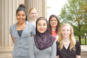 Ashley Smith (second from left), Hailah Saeed (center), and Grace Spears (right), earned UA Study Away scholarships to continue their studies this summer. They are pictured with two other UA Away scholarship recipients.