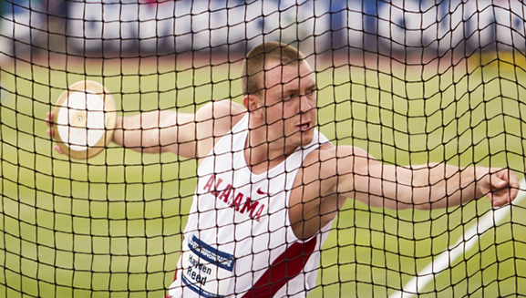 Junior Hayden Reed throws a discus