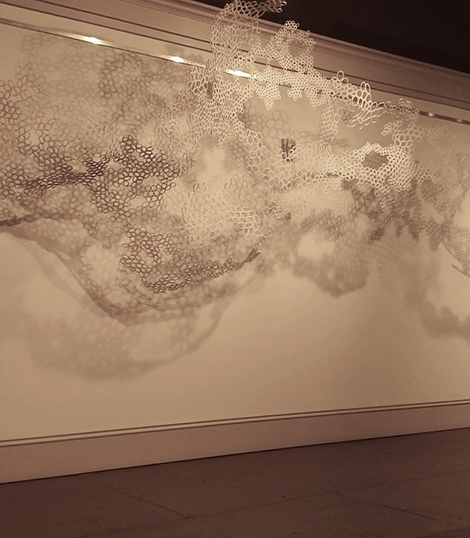 an art installation hanging in a gallery