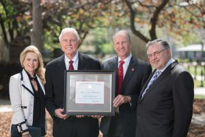 From left, Susan McCollough, Dr. Gaylon McCollough, President Stuart Bell, and Dean Robert Olin