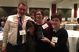 Rebecca Salzer with her family after winning the President's Faculty Research Award