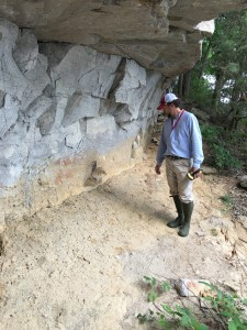 Matthew Gage, director of the UA Office of Archaeological Research, stands on a paleoflood deposit on a bluff of the Tennessee River.