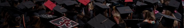 at graduation, a sea of caps and gowns