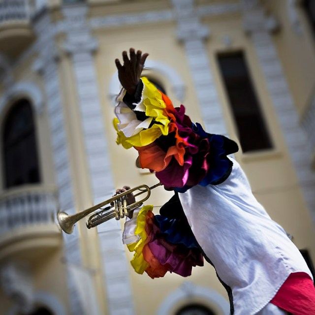 a trumpeter wearing a colorful shirt