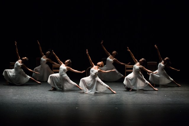 a group of dancers performing onstage