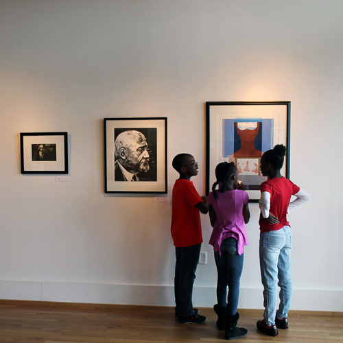 three kids studying a painting at the Paul Jones Museum