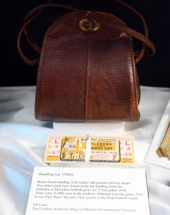 Two ticket studs were found inside this brown lizard handbag from the Alabama vs. Memphis football game on November 22, 1958.