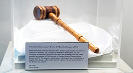 wooden gavel in a glass display case