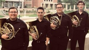 four horn players