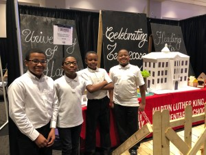 Students from Martin Luther King, Jr. Elementary show off their knowledge of Tuscaloosa history at their exhibit in the Tuscaloosa Through Time event.