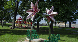 pink flower sculpture at Monnish Park titled