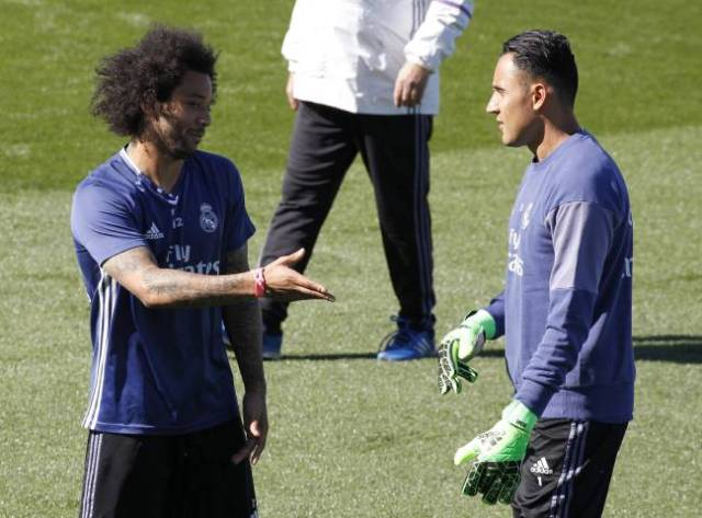 Keylor Navas and Marcelo having a chat during training for Real Madrid.
