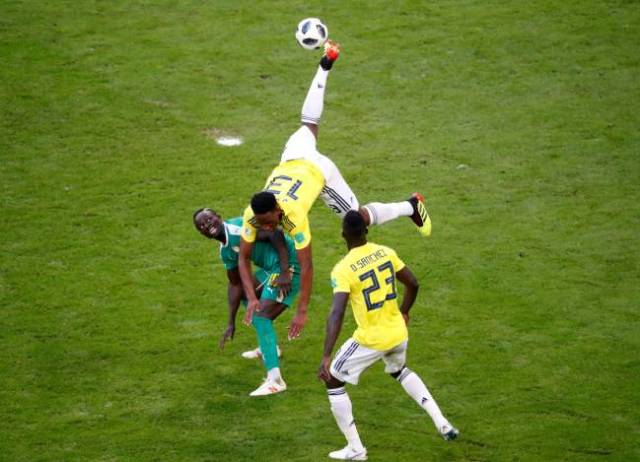 Leaving it all out there | Colombia's Yerry Mina in action with Senegal's Sadio Mane.
