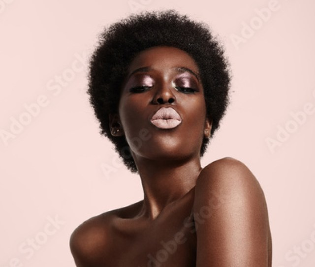 Black Woman With A Light Pink Lips Sending Kiss