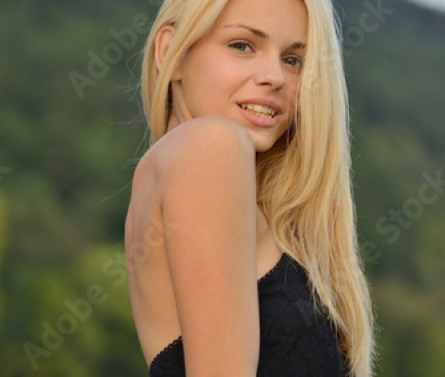 Close Up Portrait Of Blond Teenager With Mountain And Lake Background