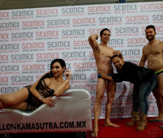 A Visitor Jokes With Stripers As A Transgender Model Poses On A Couch At The Expo Sex And Eroticism Adult Exhibition In Mexico City Mexico