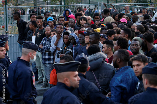 French police evict thousands of migrants living on sidewalks near     French police evict thousands of migrants living on sidewalks near the  reception center for migrants and
