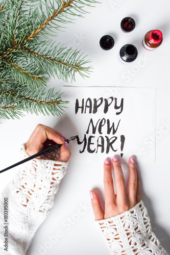 Girl writing Happy new year calligraphy card   Buy this stock photo     Girl writing Happy new year calligraphy card