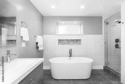 https stock adobe com images luxury bathroom interior with an oval bathtub black stone tiles and with glass shower in black and white 184105659 start checkout 1 content id 184105659