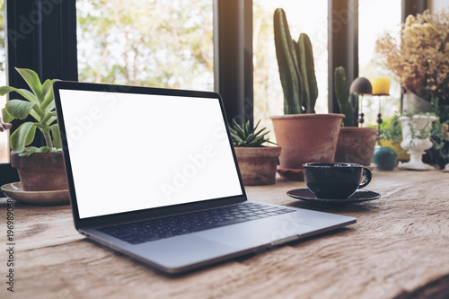 Mockup Image Of Laptop With Blank White Desktop Screen And Coffee