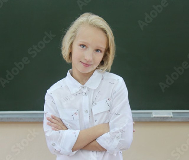 Adorable Blonde Schoolgirl   Years Old In A Classroom Near A Chalkboard Girl