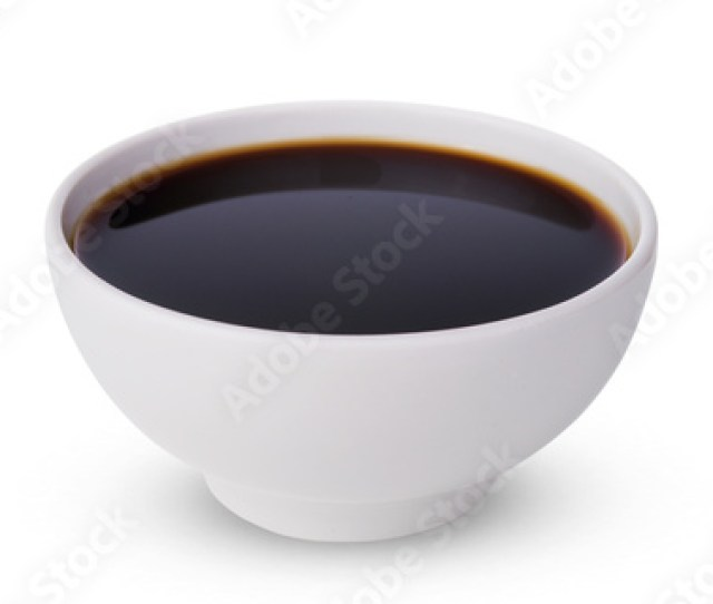 A Tasty Black Soy Sauce In Bowl Isolated On White Background