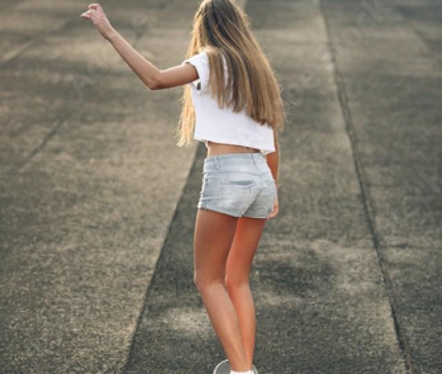 Cute Beautiful Young And Sexy Teen Girl In A White T Shirt Short Shorts