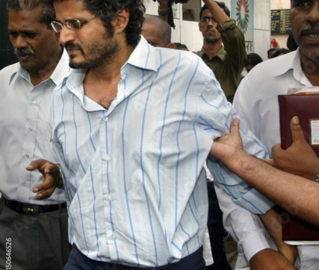 Indian Policemen Escort Bollywood Filmmaker Gustad To A Police Station In Bombay