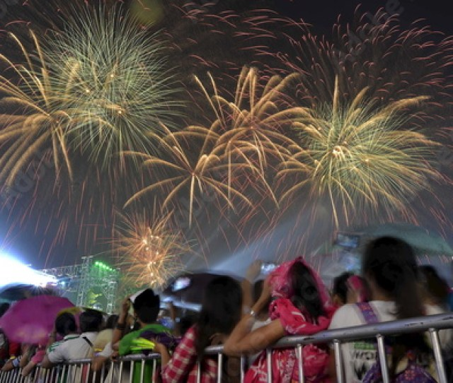 Revelers Watch As Fireworks Explode During New Year Celebrations Outside The Philippine Arena In Bocaue Town
