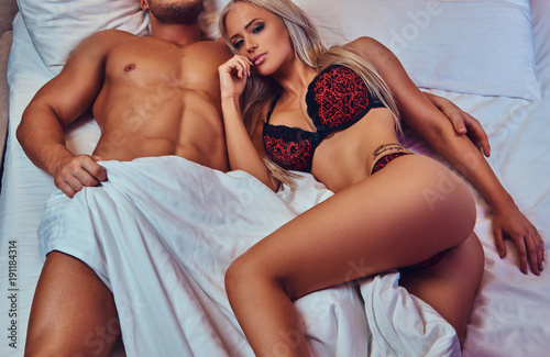 Portrait Of Sexy Husband And Wife Relaxing In Bed Honeymoon