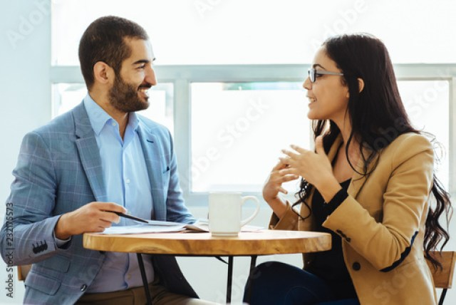 Couple of young arab executives talking while taking a break in a day at  the office. - Buy this stock photo and explore similar images at Adobe  Stock | Adobe Stock