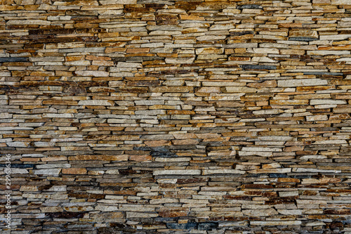 https stock adobe com images wall of stone slate pattern of decorative slate stone wall surface a wall of natural flat stones texture for background many slate tiles on a wall creating an interresting texture 299636346 start checkout 1 content id 299636346