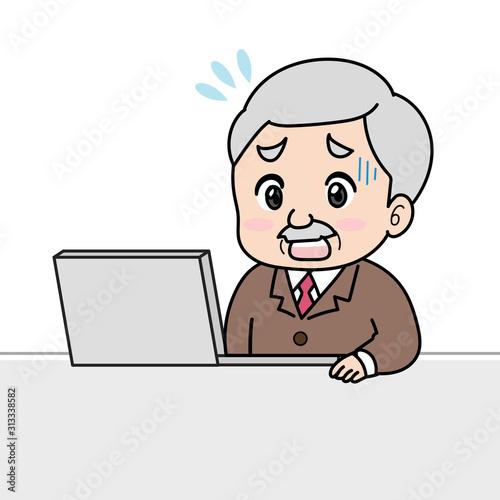 ノートパソコンを使って困り顔な年配男性