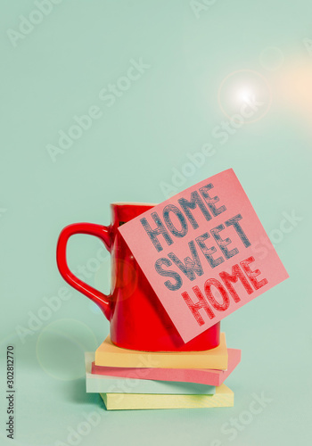 What does 'home sweet home' mean? Conceptual Hand Writing Showing Home Sweet Home Concept Meaning In House Finally Comfortable Feeling Relaxed Family Time Coffee Cup Colored Sticky Note Stacked Pads Plain Background Stock Photo Adobe Stock