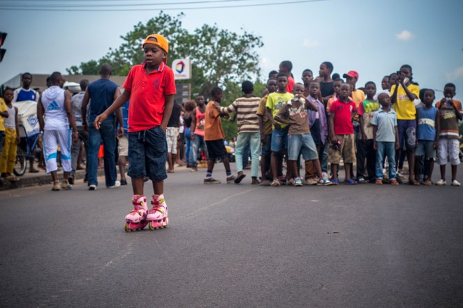 A boy on roller blades during the yam festival carnival