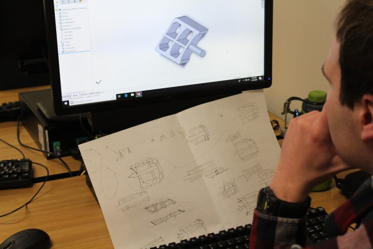 Student working on the design of a bike pedal using CAD software
