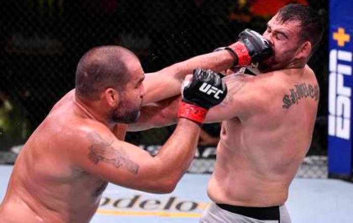 Bulgarian Blagoy Ivanov (red) hits Augusto Sakai (blue) in the penultimate fight of the evening. Photo: Jeff Bottari / Zuffa via USA TODAY Sports