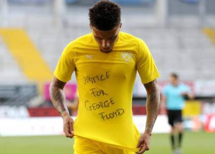 Jadon Sancho displaying a message for the death of George Floyd, during a Bunddesliga match against SC Paderborn - Reuters