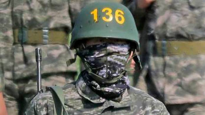 They are, with bulletproof helmets, in one of the camps in South Korea (Park Ji-ho / Yonhap via AP)
