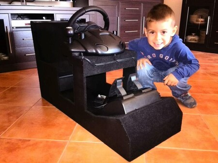 Abel with the cockpit that his father made for him when he was 4 years old